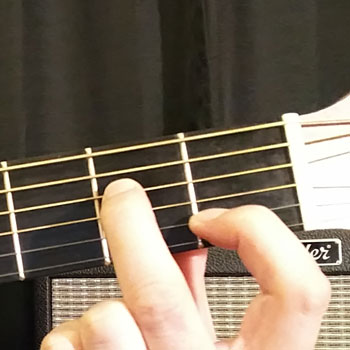 Example of How to Play an Open A Minor Dominant 7 Chord on the Guitar